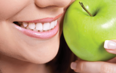 Healthy smile and an apple