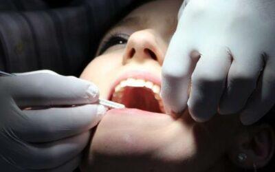Dental professional working on teeth