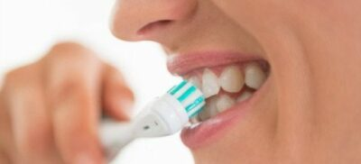 Brushing with an electric toothbrush